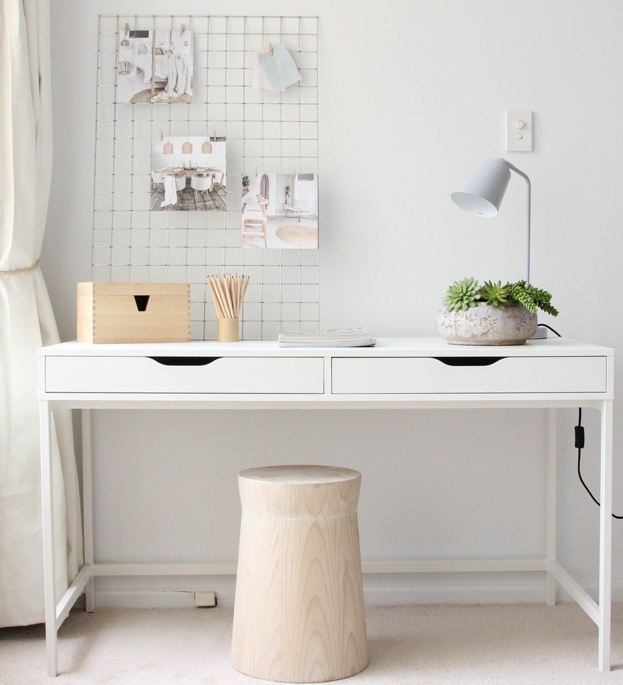 Inspiration for a small scandinavian freestanding desk carpeted study room remodel in Sydney with white walls