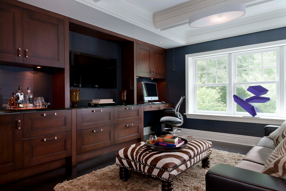 Trendy built-in desk study room photo in New York with black walls