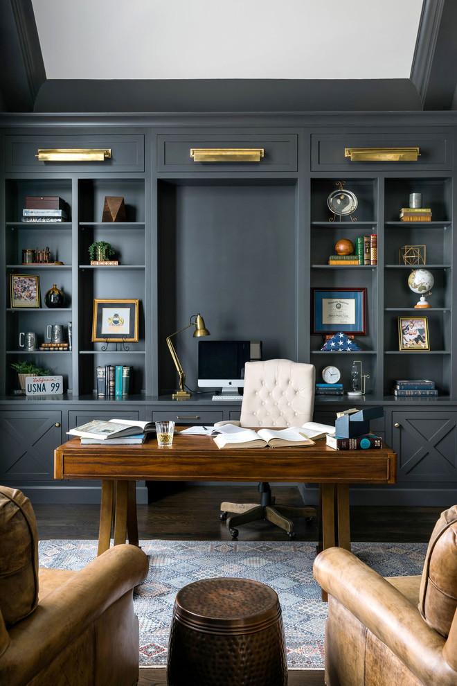 Large transitional freestanding desk dark wood floor and brown floor study room photo in Atlanta with gray walls