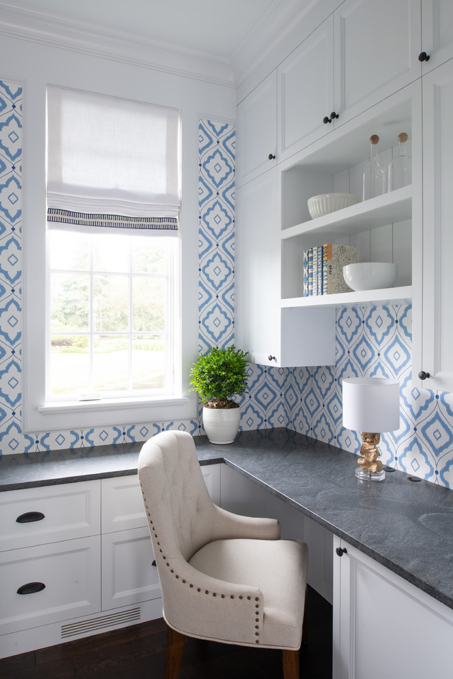 Inspiration for a small transitional built-in desk dark wood floor and brown floor study room remodel in Minneapolis with blue walls and no fireplace