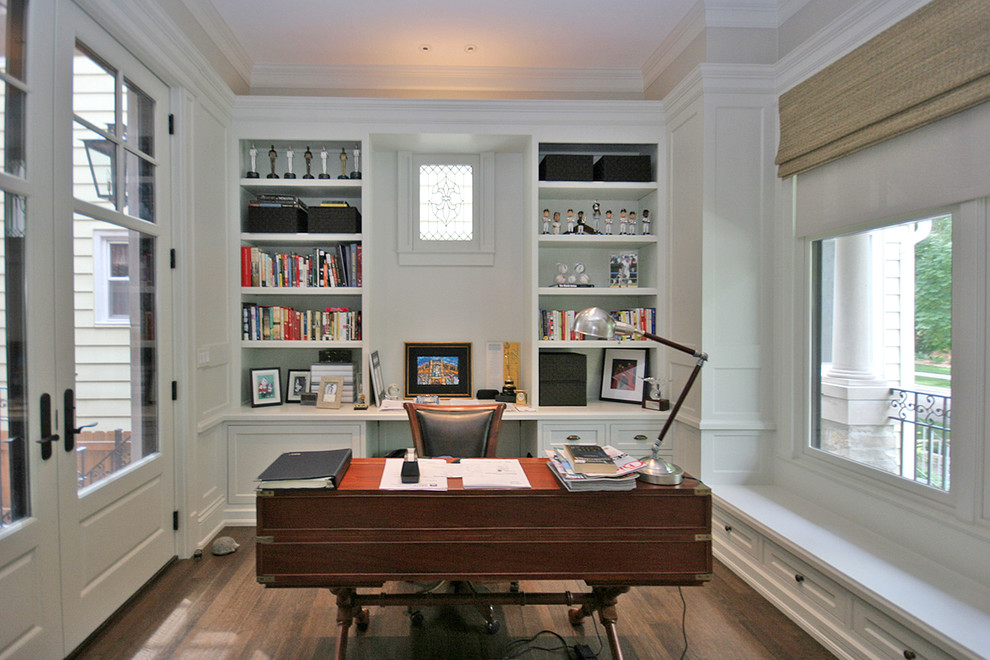 Example of a mid-sized classic freestanding desk medium tone wood floor study room design in Chicago with gray walls