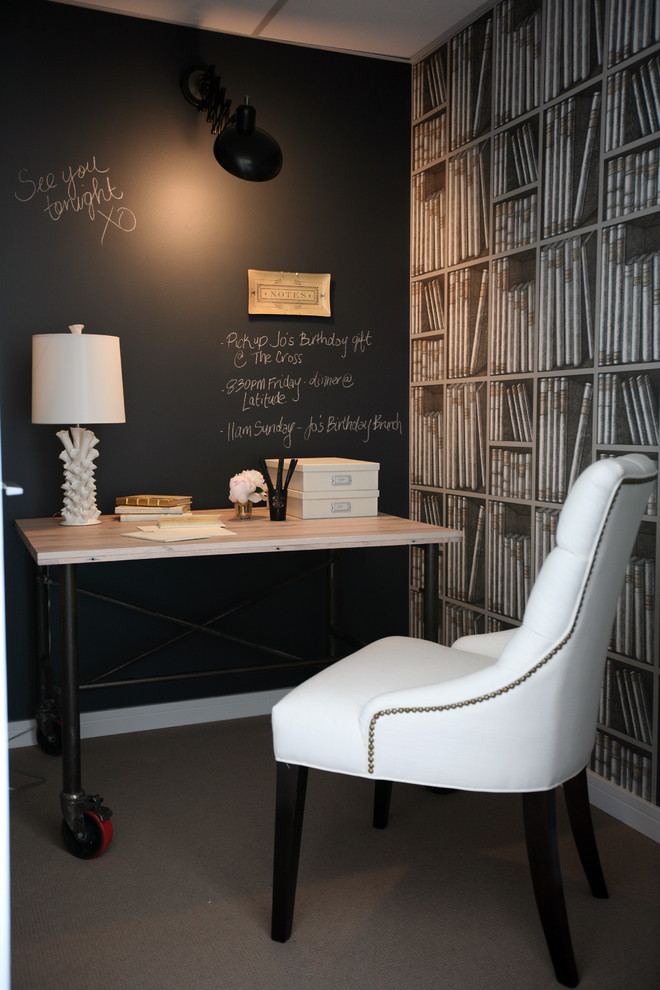 Inspiration for a timeless freestanding desk carpeted home office remodel in Vancouver with black walls