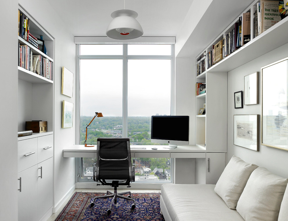 Study room - small scandinavian built-in desk study room idea in Toronto with white walls