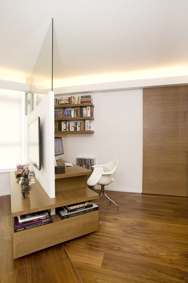 Example of a trendy home office design in Hong Kong with white walls
