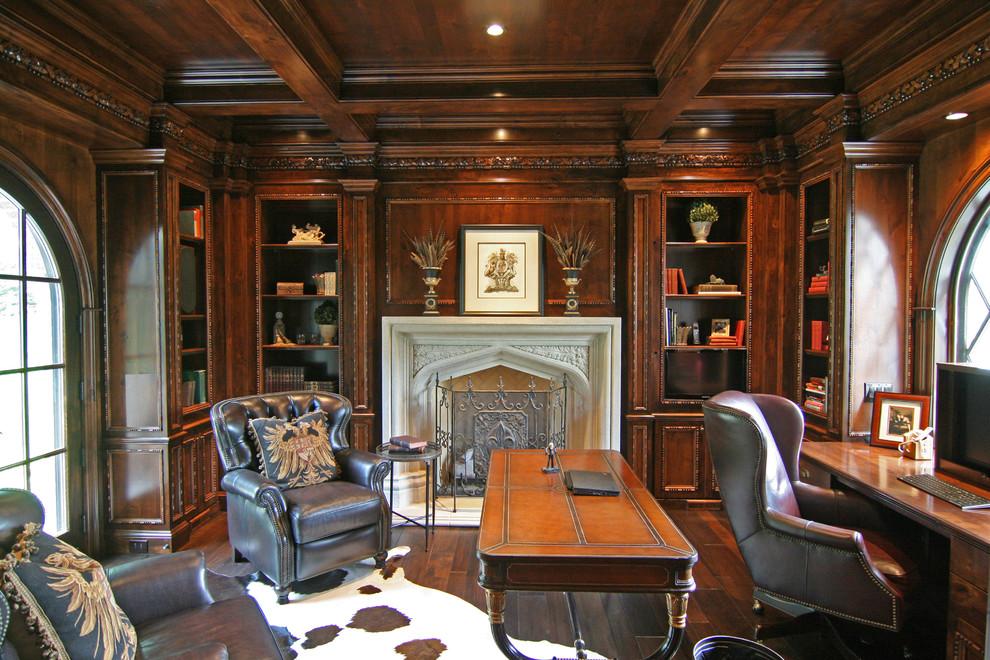 Home office - traditional built-in desk dark wood floor home office idea in Minneapolis
