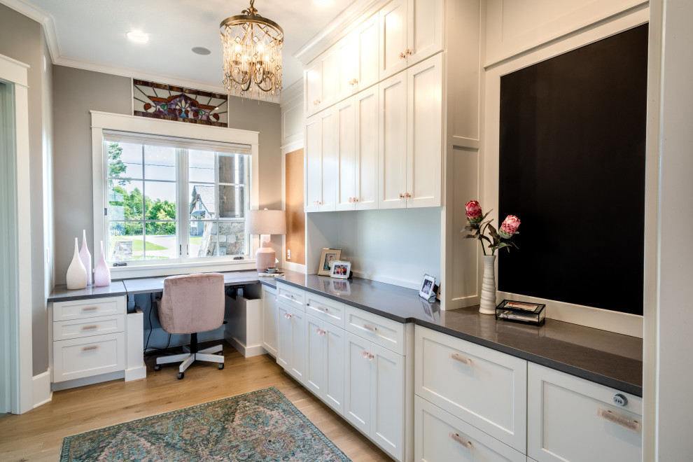 Inspiration for a transitional built-in desk medium tone wood floor and brown floor study room remodel in Minneapolis with gray walls and no fireplace
