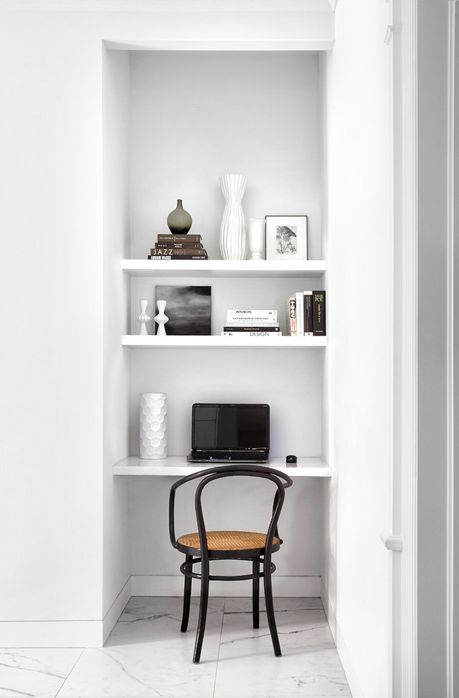 Home office - scandinavian built-in desk white floor home office idea in Toronto with white walls