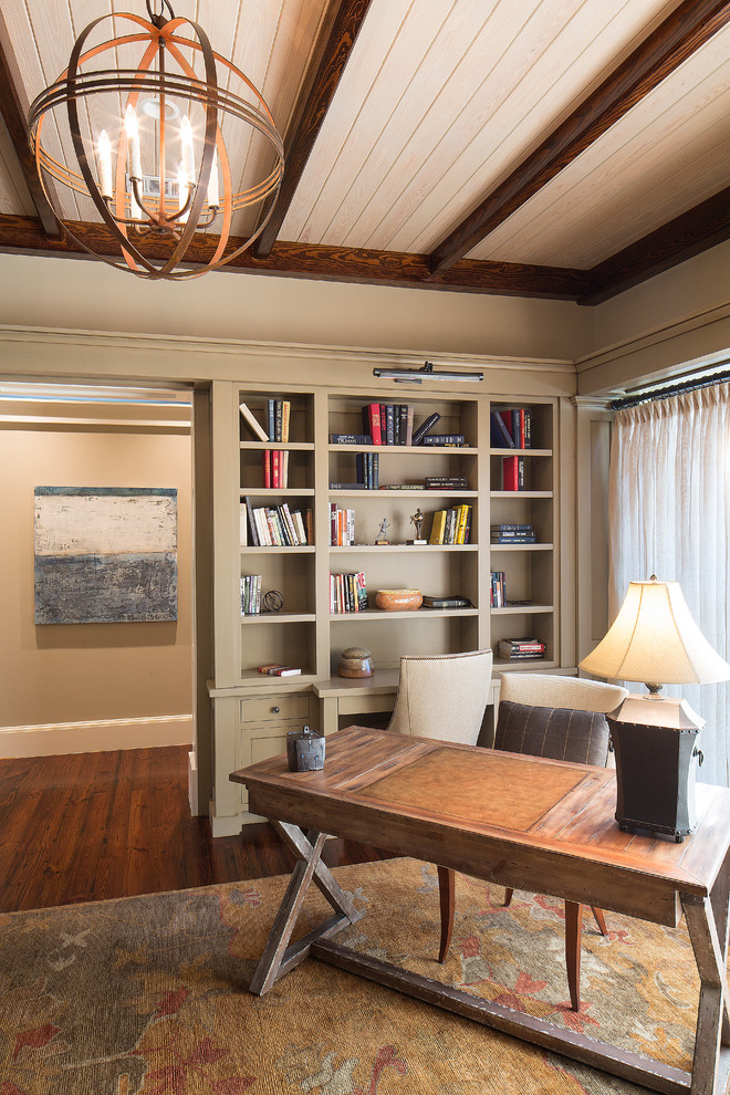Home office - mid-sized traditional freestanding desk dark wood floor home office idea in Charleston with beige walls