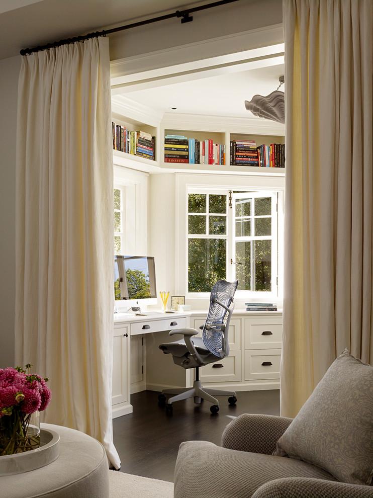 Elegant built-in desk dark wood floor study room photo in San Francisco