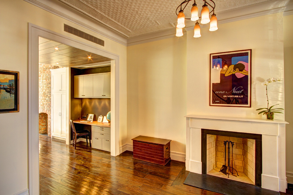 Elegant built-in desk home office photo in New York