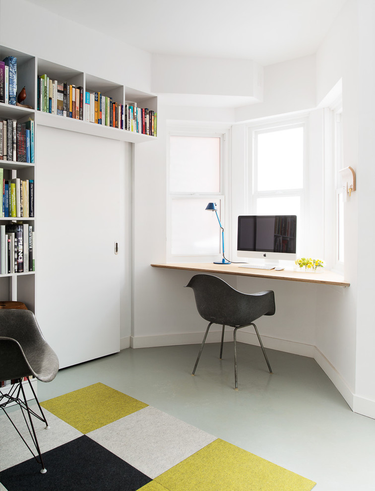 Inspiration for a contemporary built-in desk gray floor home office remodel in Toronto with white walls