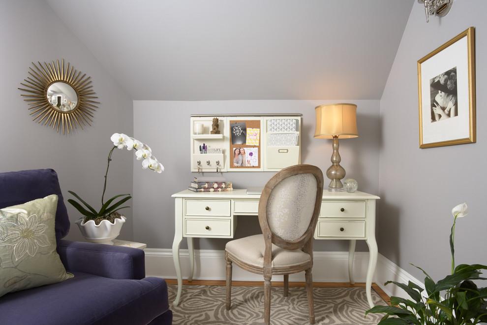 Elegant freestanding desk medium tone wood floor home office photo in Minneapolis with gray walls