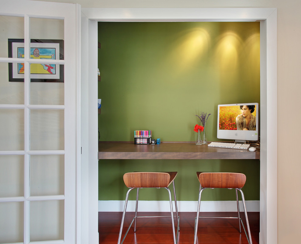 Trendy brown floor home office photo in Orange County with white walls