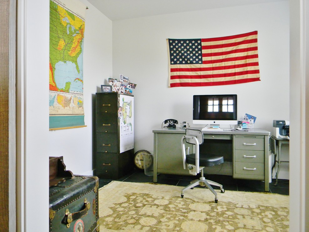 Inspiration for a cottage freestanding desk home office remodel in Seattle with white walls