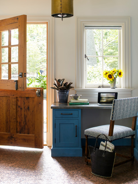 Study room - cottage built-in desk study room idea in New York with white walls