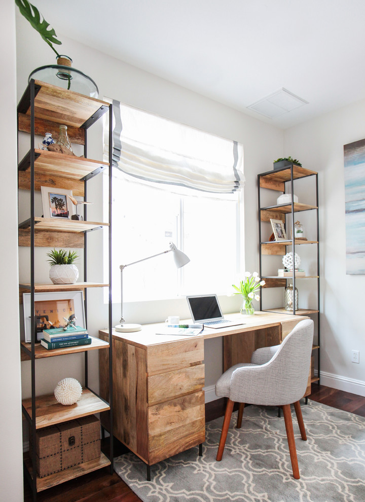 Inspiration for a coastal freestanding desk dark wood floor home office remodel in Los Angeles with white walls