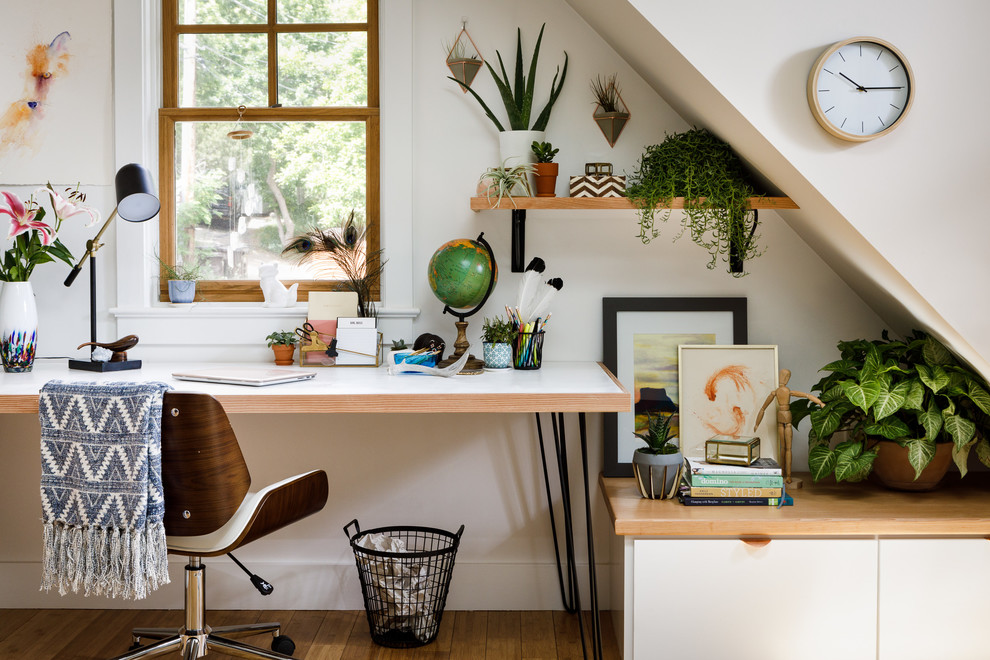Trendy freestanding desk study room photo in Denver with white walls