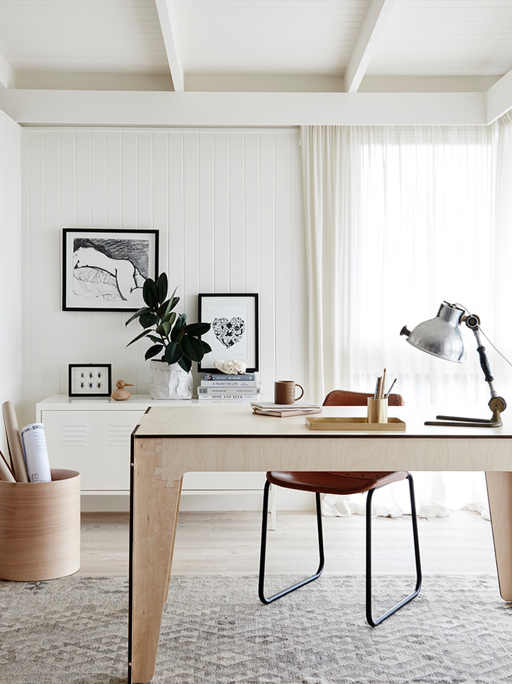 Danish freestanding desk study room photo in Melbourne with white walls