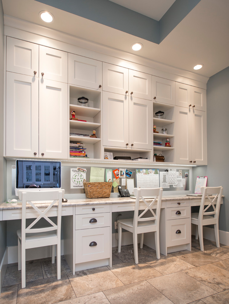Example of a mid-sized transitional built-in desk ceramic tile study room design in Calgary with gray walls and no fireplace