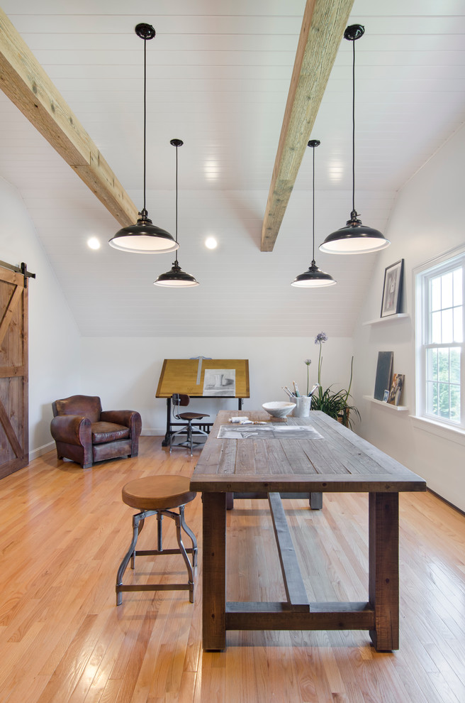 Home studio - large farmhouse freestanding desk medium tone wood floor home studio idea in Boston with white walls and no fireplace