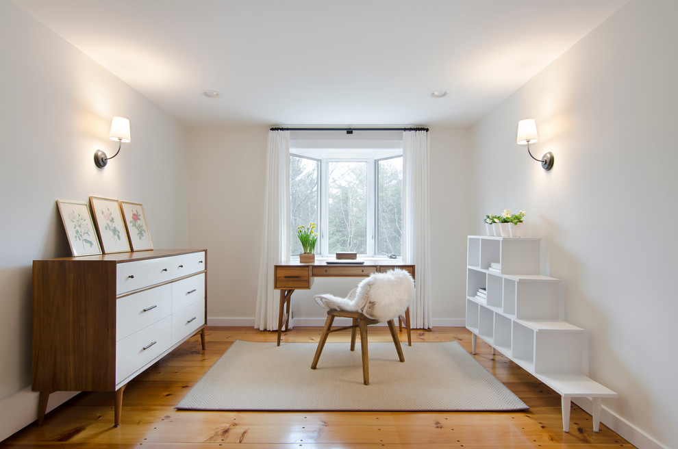 Small minimalist freestanding desk light wood floor home office photo in Boston with gray walls and no fireplace