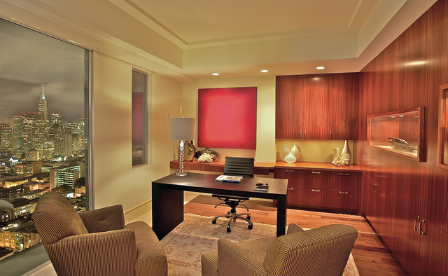 Home office - contemporary freestanding desk medium tone wood floor home office idea in San Francisco with beige walls