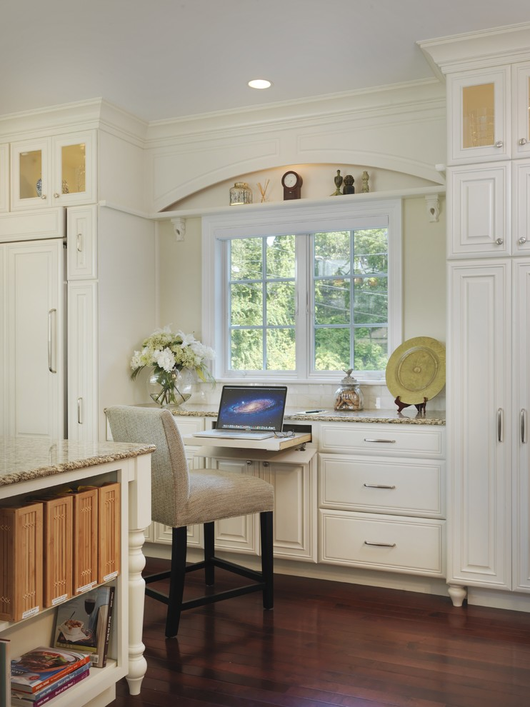 Inspiration for a timeless built-in desk medium tone wood floor study room remodel in Providence with white walls