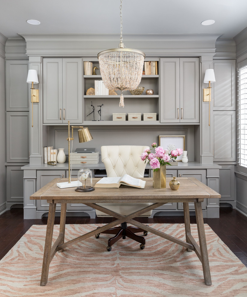 Example of a transitional freestanding desk dark wood floor, brown floor and wall paneling study room design in Houston with gray walls and no fireplace