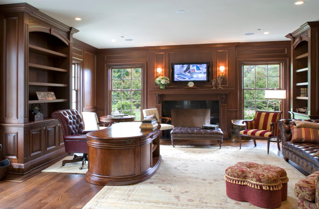 Inspiration for a large timeless freestanding desk medium tone wood floor study room remodel in New York with brown walls and a standard fireplace