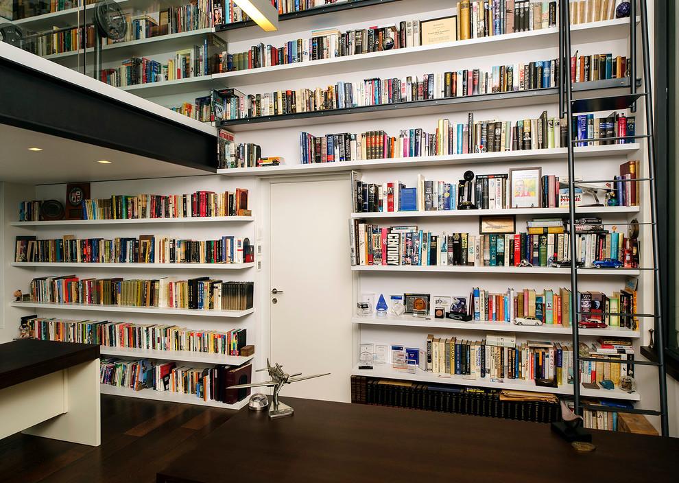 Home office - modern dark wood floor home office idea in Tel Aviv with white walls