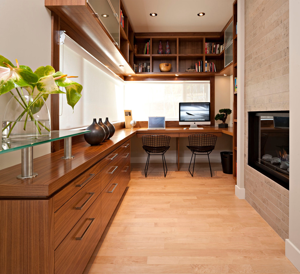 Minimalist built-in desk home office photo in Calgary