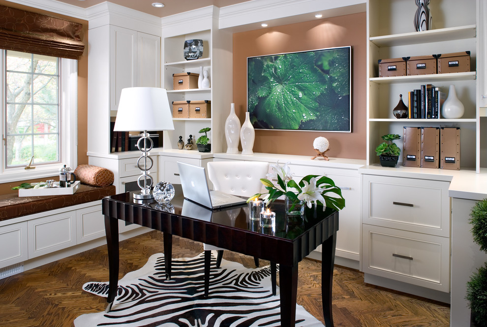 Inspiration for a large contemporary freestanding desk dark wood floor and brown floor home office remodel in Toronto with brown walls and no fireplace