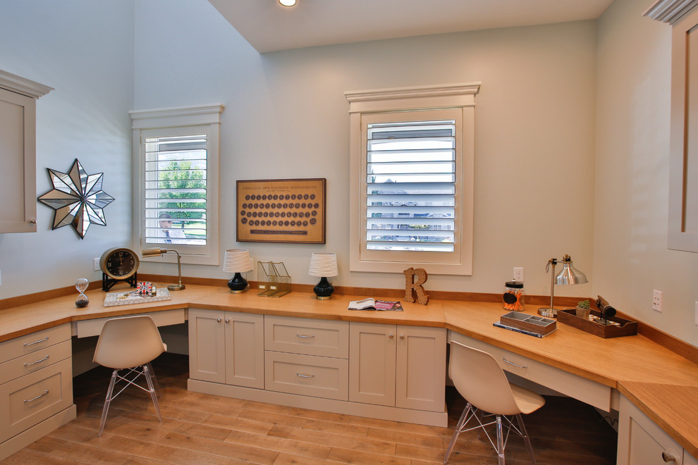 Study room - large built-in desk light wood floor study room idea in Salt Lake City with gray walls and no fireplace