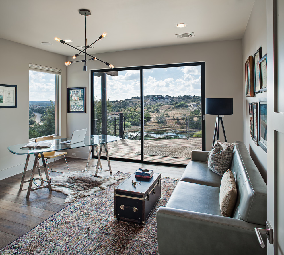 Inspiration for a mid-sized transitional freestanding desk dark wood floor and brown floor study room remodel in Austin with beige walls and no fireplace
