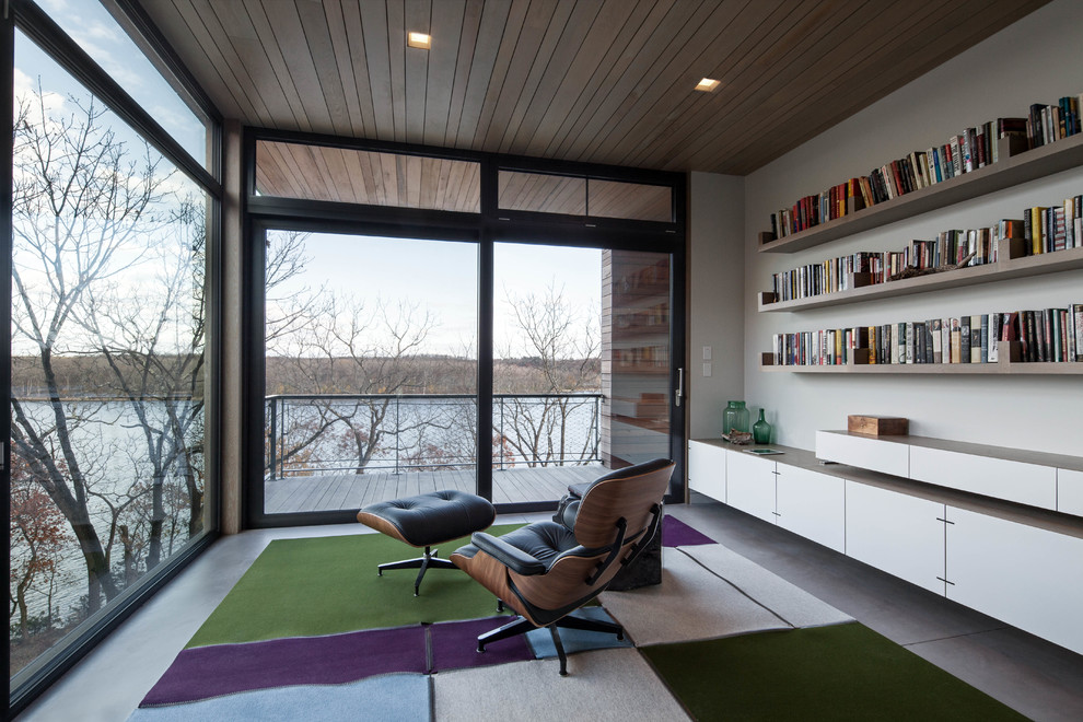 Home office - contemporary built-in desk home office idea in New York with white walls
