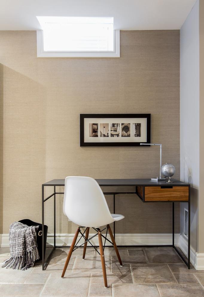 Trendy freestanding desk home office photo in Toronto with beige walls