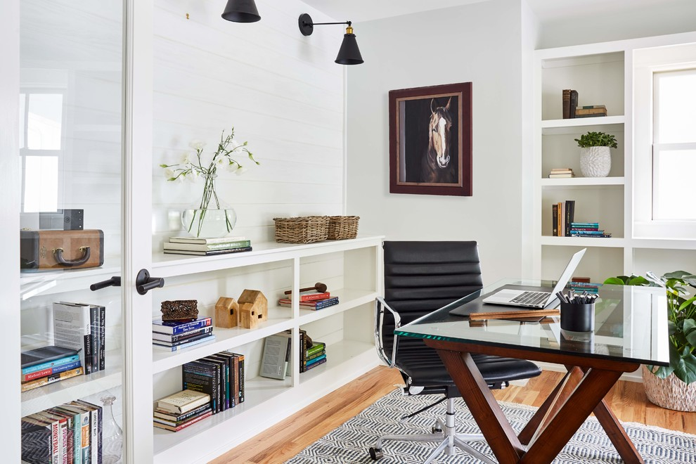 Example of a mid-sized farmhouse freestanding desk brown floor and light wood floor study room design in Richmond with white walls and no fireplace