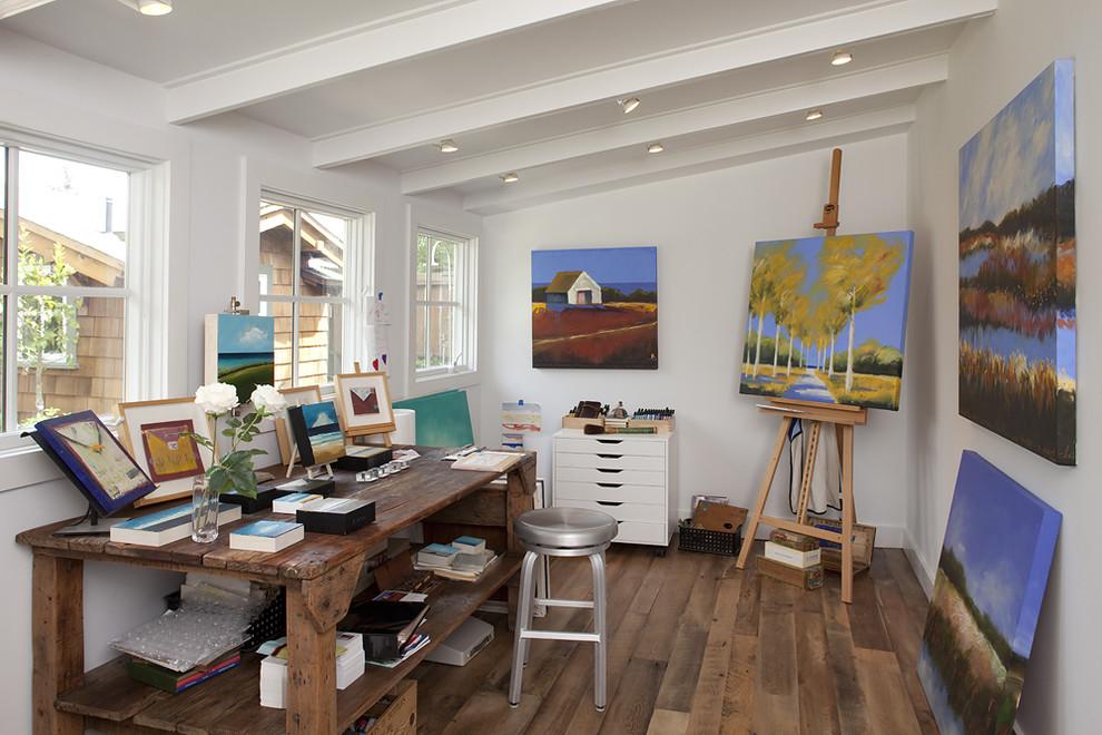 Home studio - rustic freestanding desk dark wood floor home studio idea in San Francisco with white walls