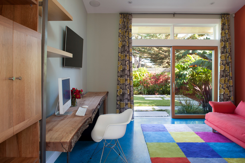 Inspiration for a contemporary concrete floor and blue floor home office remodel in San Francisco with gray walls