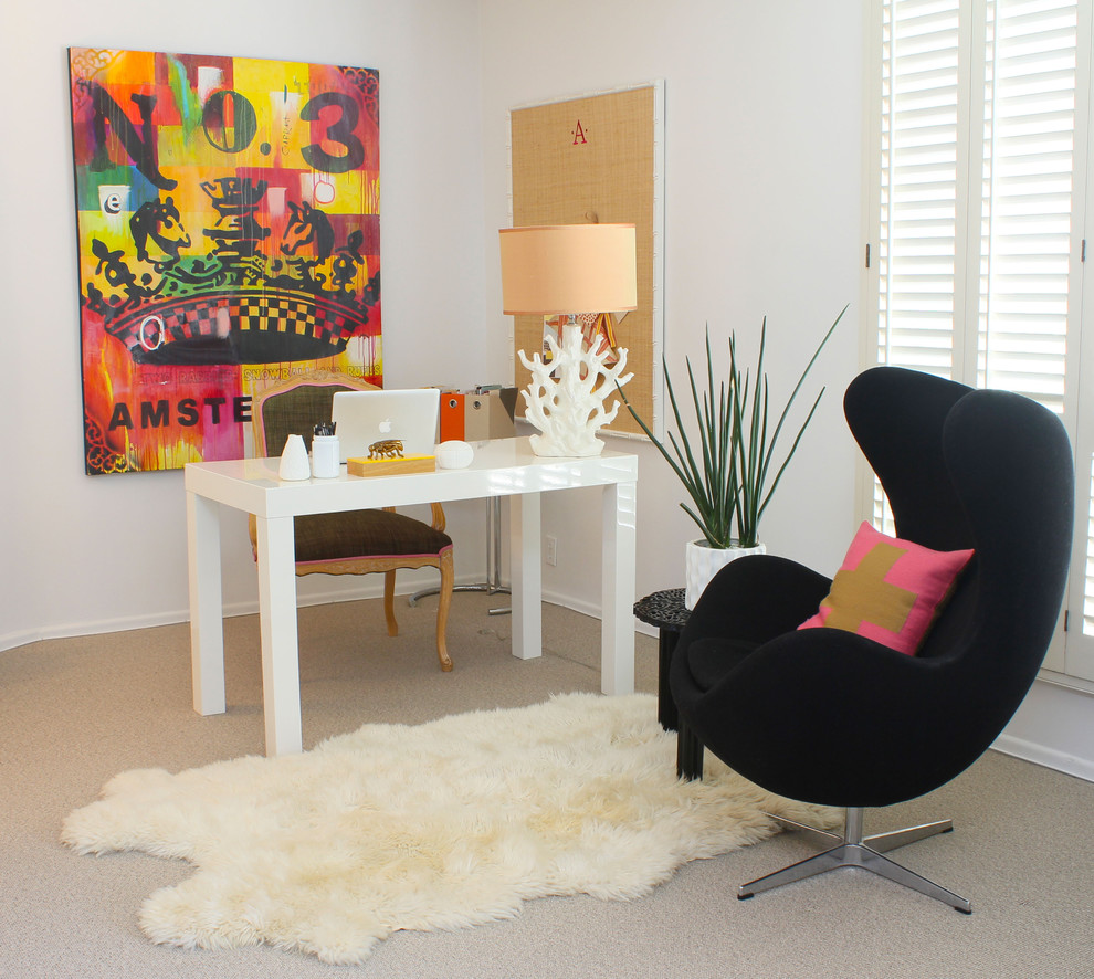 Inspiration for a contemporary freestanding desk carpeted home office remodel in Los Angeles with white walls