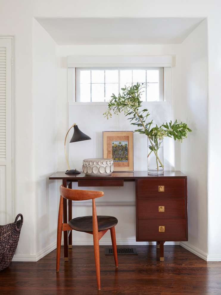 Inspiration for a mediterranean freestanding desk dark wood floor home office remodel in Los Angeles with white walls