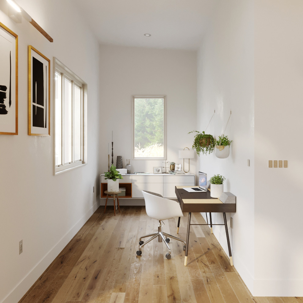 Inspiration for a small scandinavian freestanding desk light wood floor and brown floor study room remodel in San Francisco with white walls and no fireplace