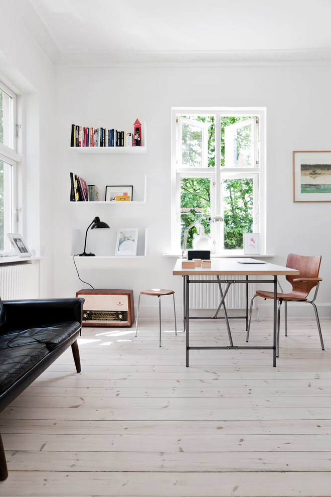 Mid-sized danish freestanding desk light wood floor home office photo in London with white walls