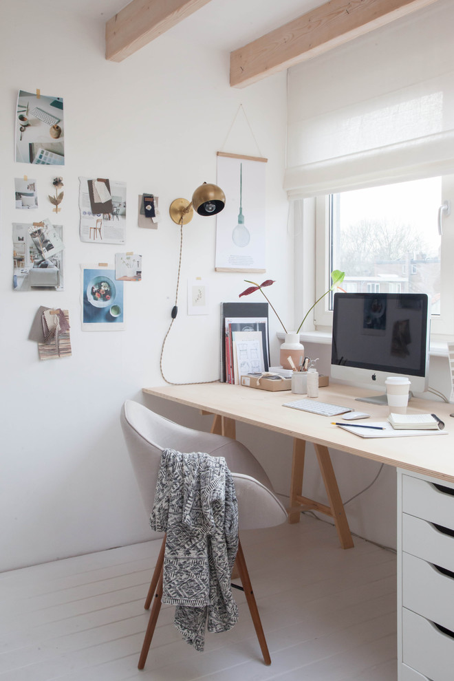 Home studio - small scandinavian freestanding desk painted wood floor home studio idea in Amsterdam with white walls and no fireplace