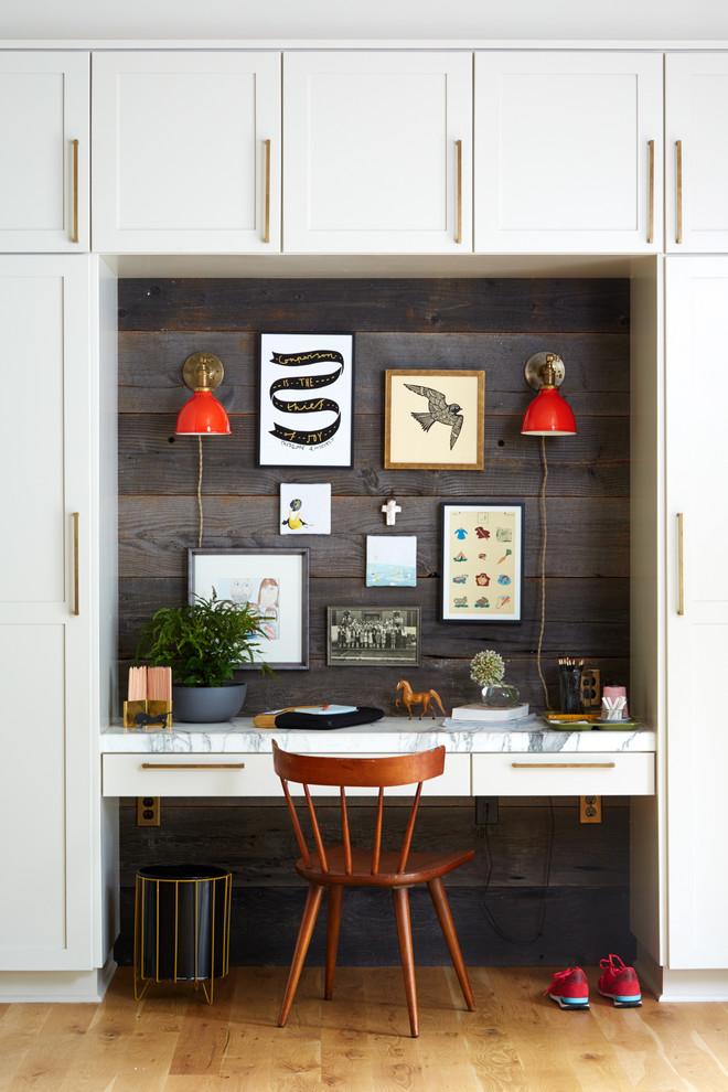 Example of a farmhouse built-in desk light wood floor study room design in Portland