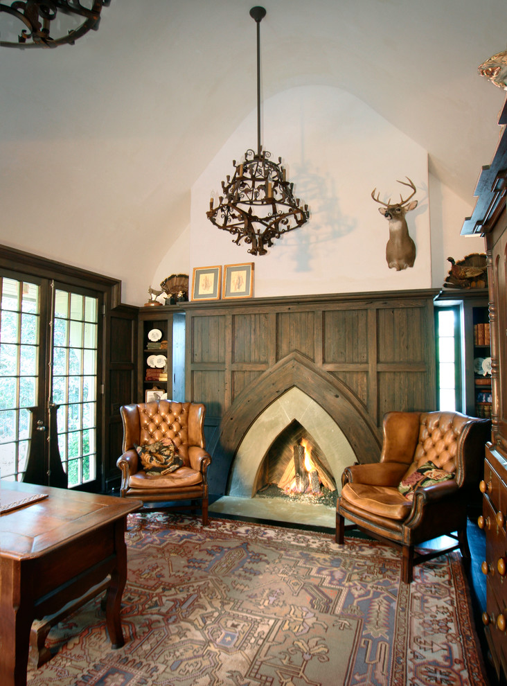 Home office - traditional home office idea in Charlotte with beige walls, a standard fireplace and a concrete fireplace