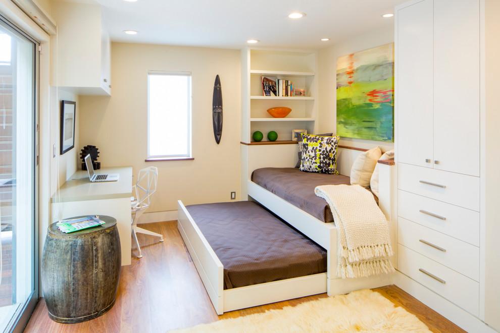 Trendy freestanding desk medium tone wood floor home office photo in San Francisco with beige walls