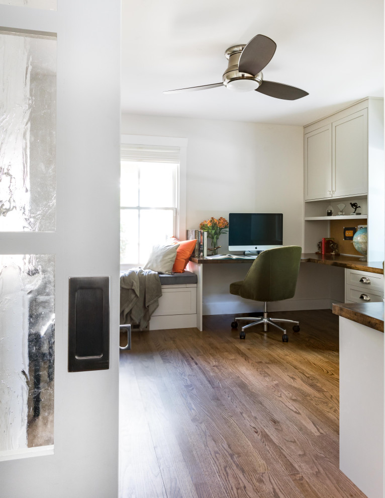 Example of a transitional home office design in Sacramento