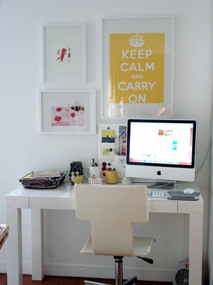 Trendy freestanding desk home office photo in San Francisco with white walls
