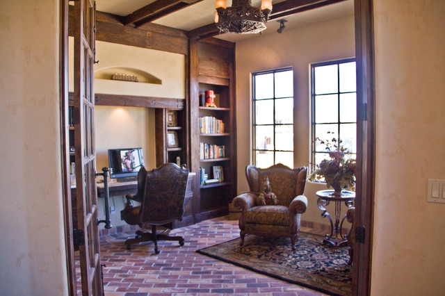 Mountain style built-in desk brick floor study room photo in Austin